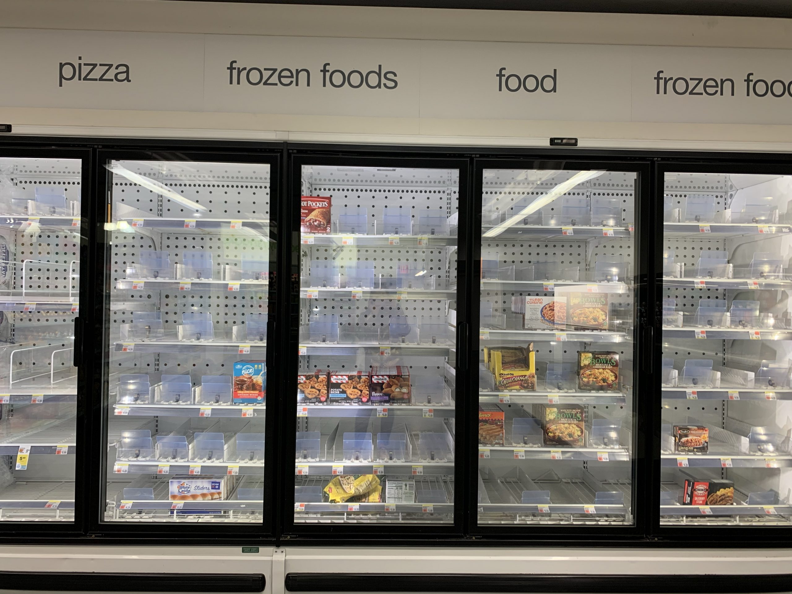 Empty shelves of the frozen foods section