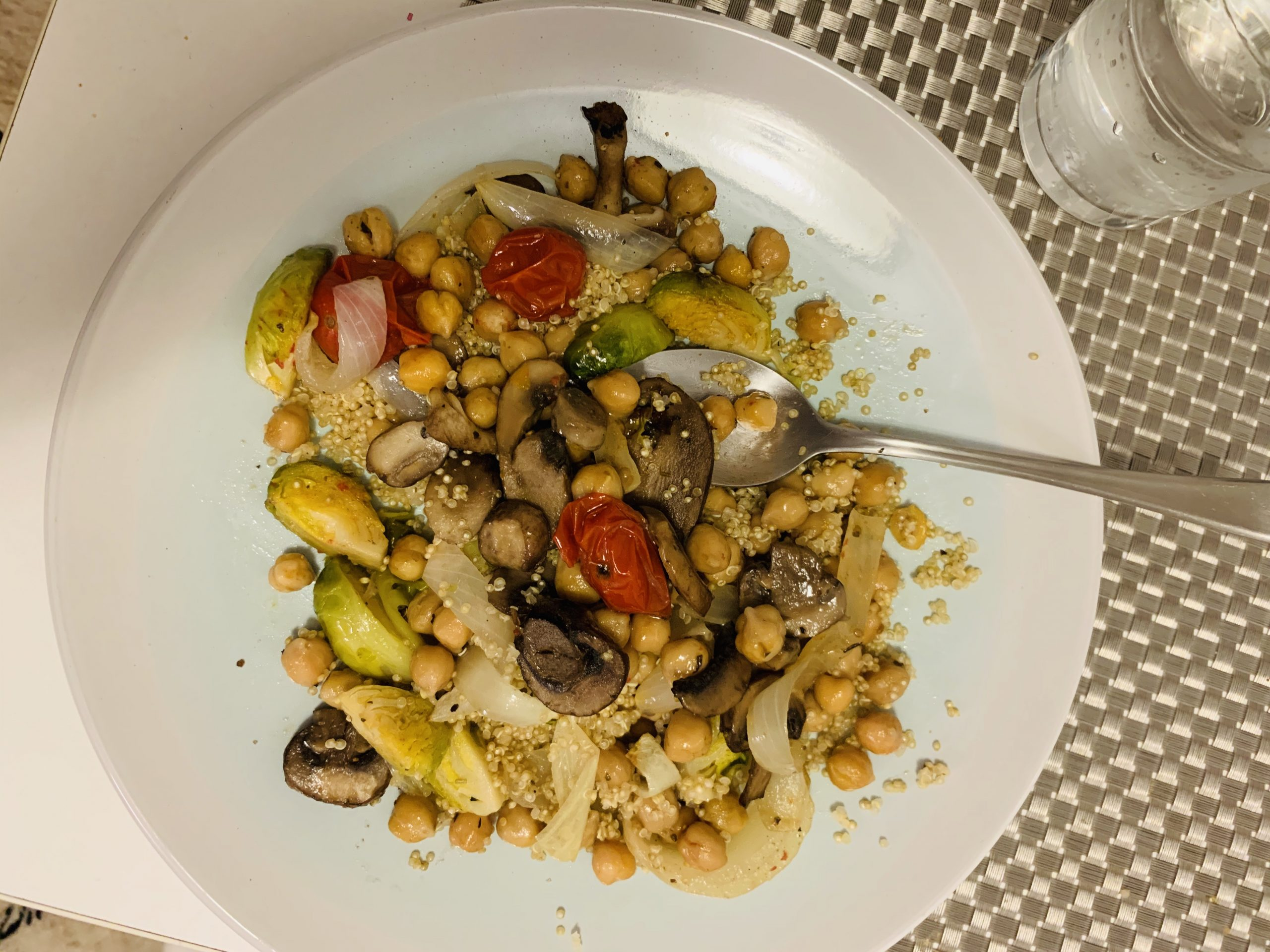 roasted tomatoes, mushrooms, onions and quinoa on a plate