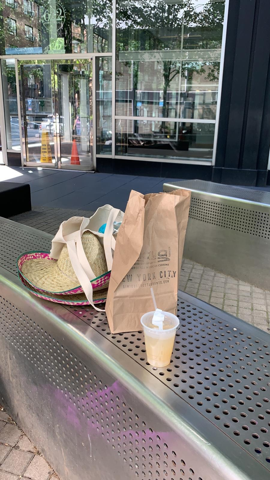 Sombreros, Brown paper Bag and a margariat on a steel bench