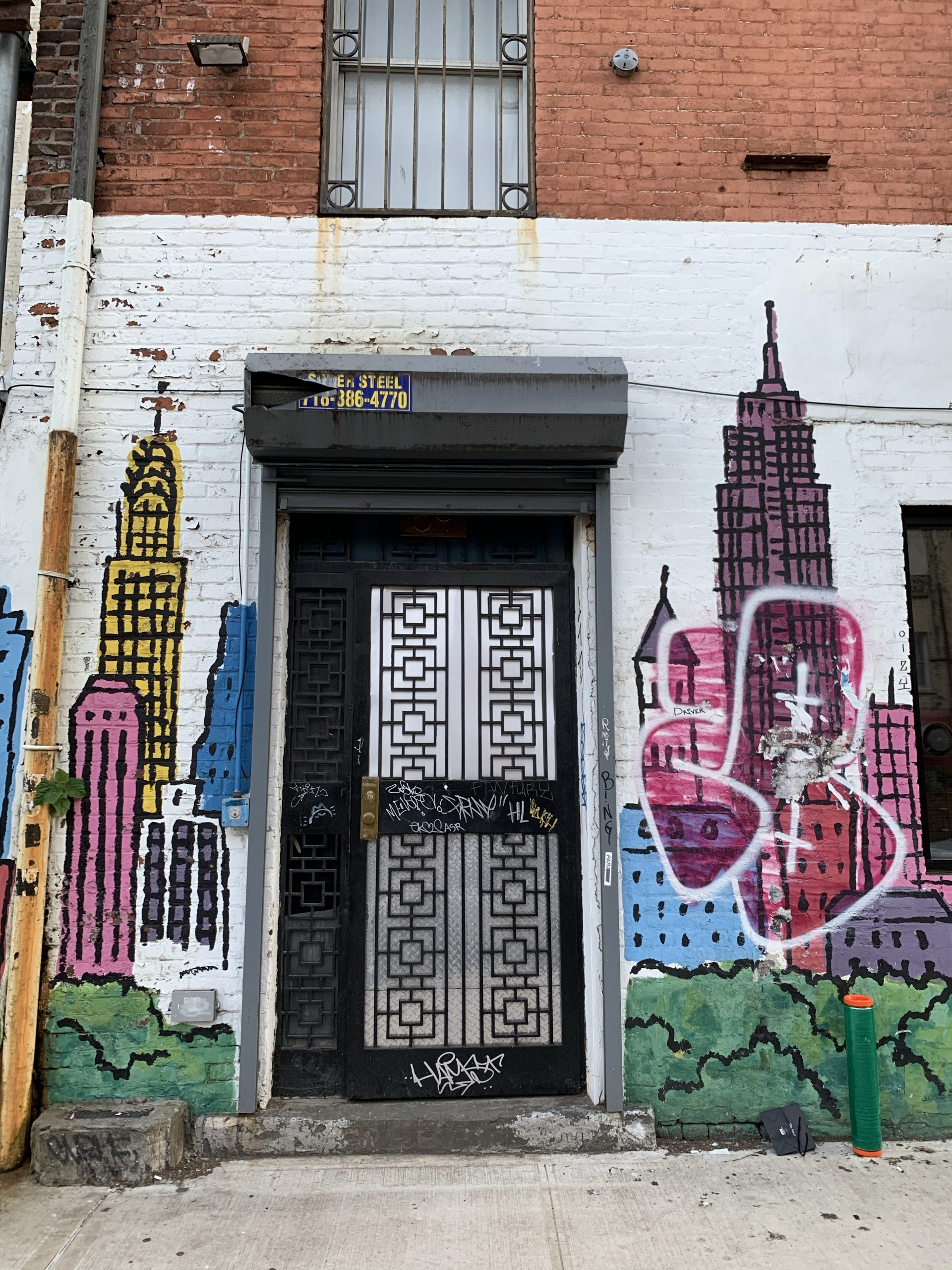 Street art of NYC buildings and a door
