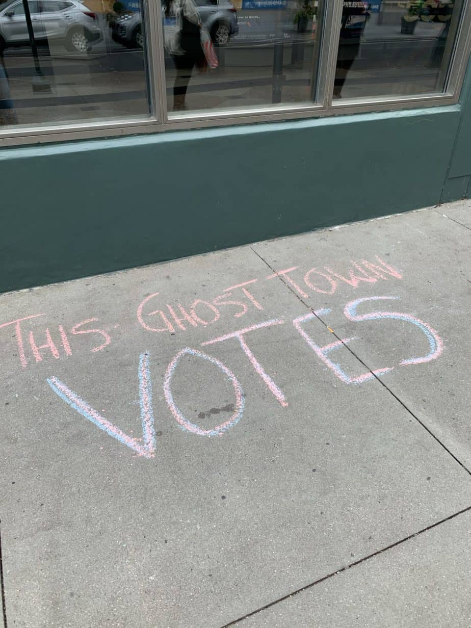 This Ghost Town Votes written in chalk on pavement
