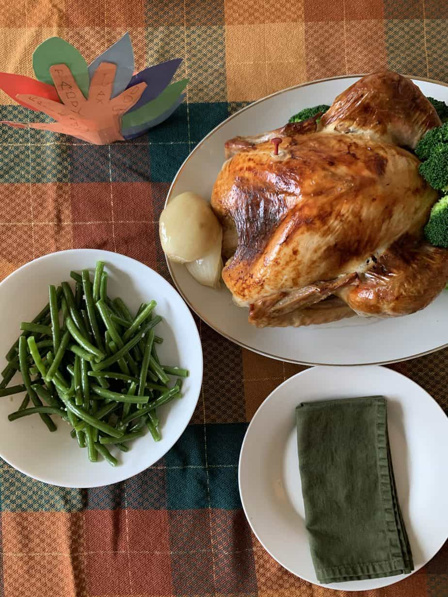 Turkey and green beans on fall colors plaid tablecloth