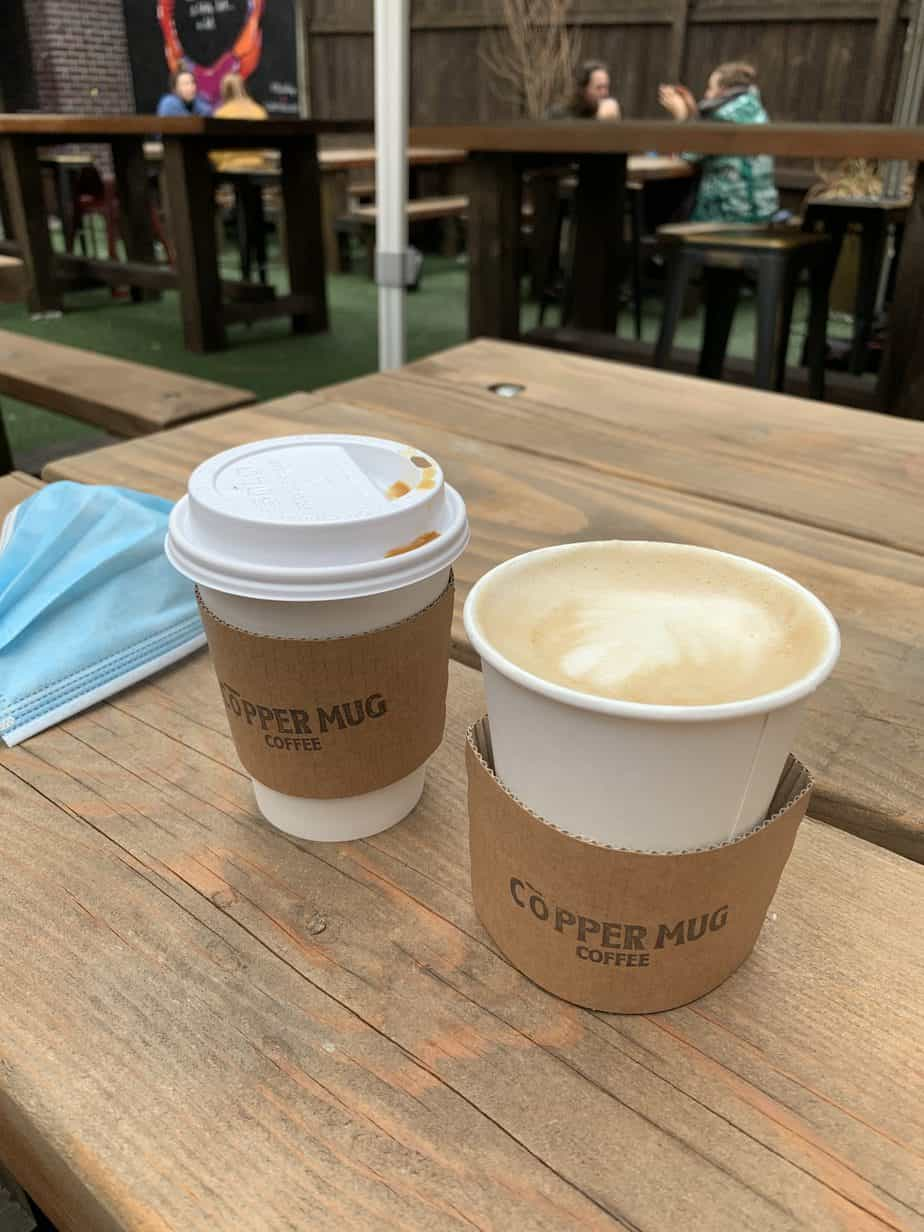 two cups of coffee on a wooden table